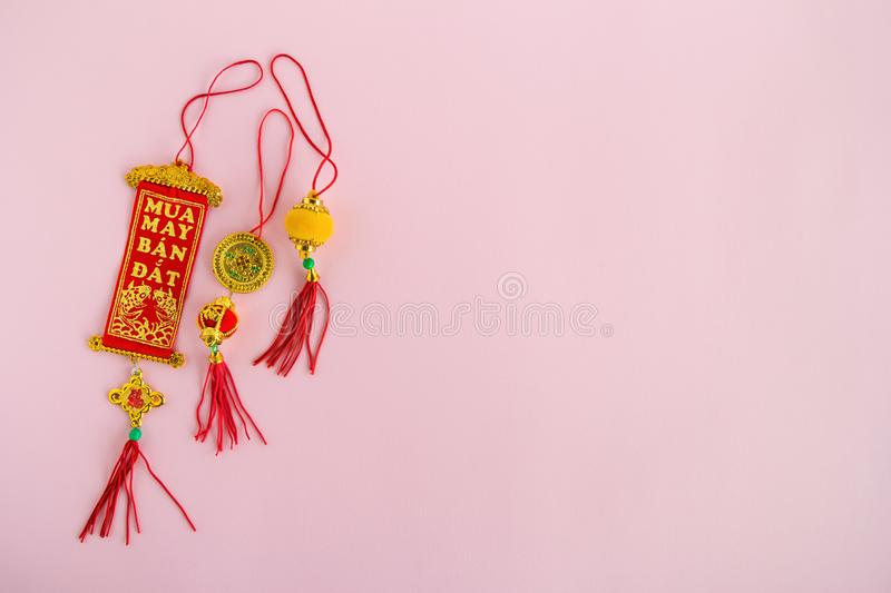 Traditional Vietnamese and Chinese New Year decorations red and golden colors on a pink background. stock photo