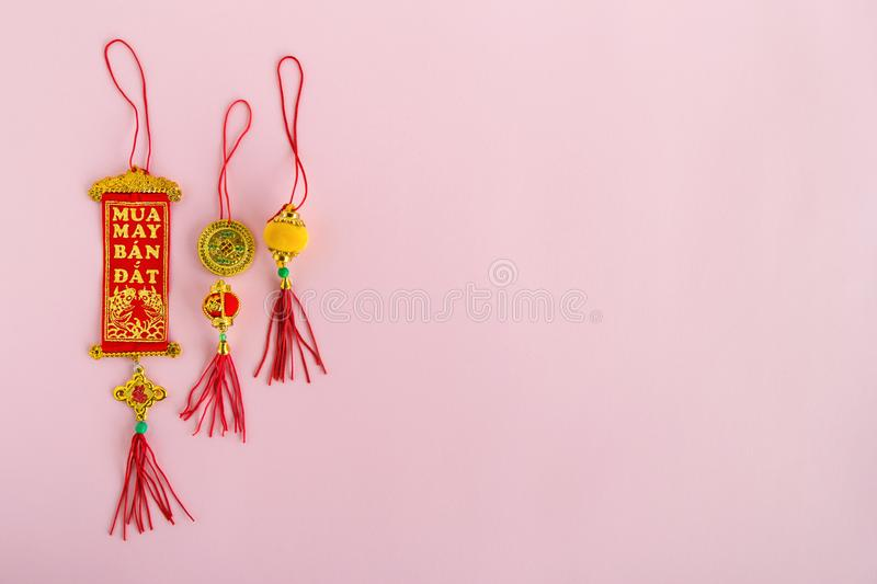 Traditional Vietnamese and Chinese New Year decorations red and golden colors on a pink background. stock image