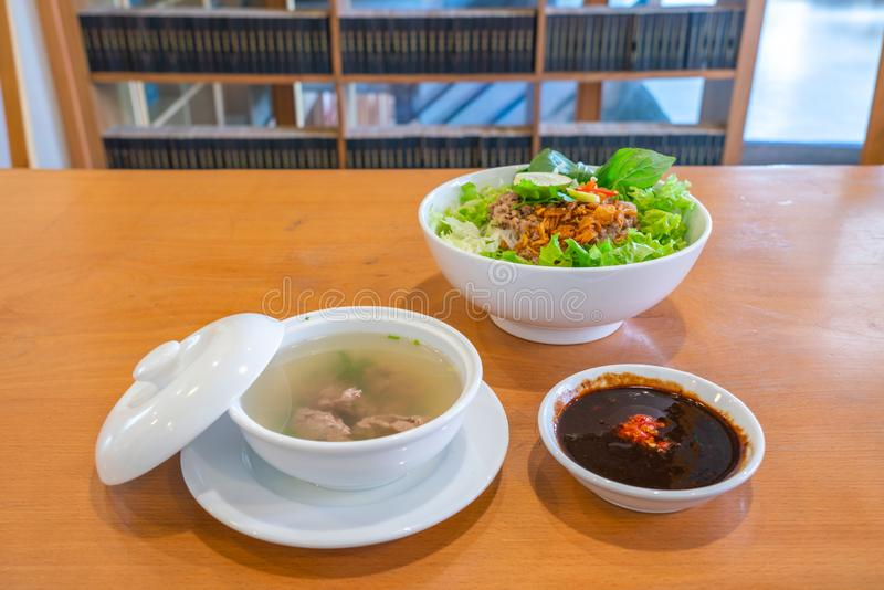 Traditional Vietnamese cuisine noodles soup with herbs and fresh vegetables. Traditional Vietnamese pork noodles soup with herbs and fresh vegetables stock image