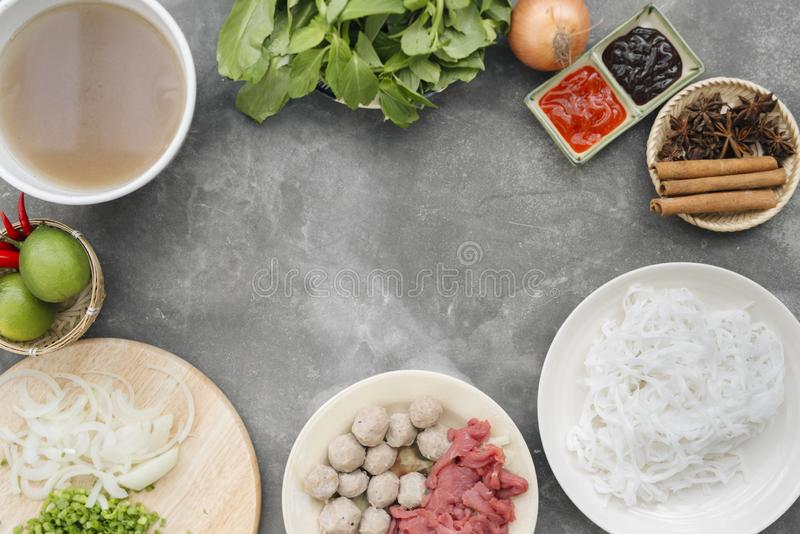 Traditional vietnamese noodle soups pho in bowls, concrete background. Vietnamese beef soup pho bo, Close-up. Asian/vietnamese royalty free stock photo