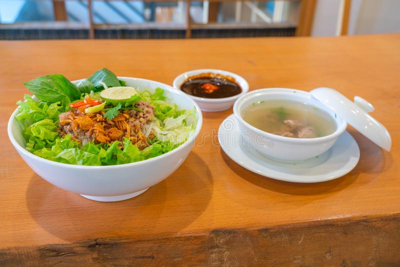 Traditional Vietnamese pork noodle soup with vegetables and herbs. Traditional Vietnamese cuisine pork noodle soup with vegetables and herbs stock image