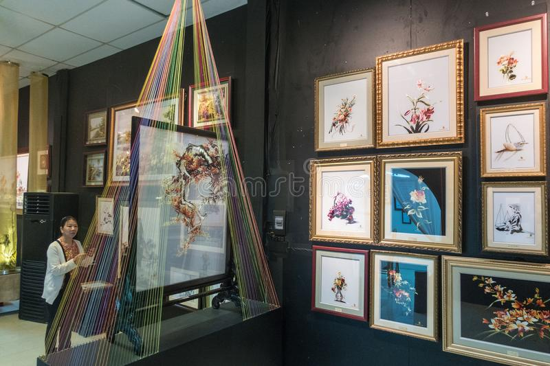 Traditional Vietnamese Silk Paintings being prepared and display royalty free stock photo