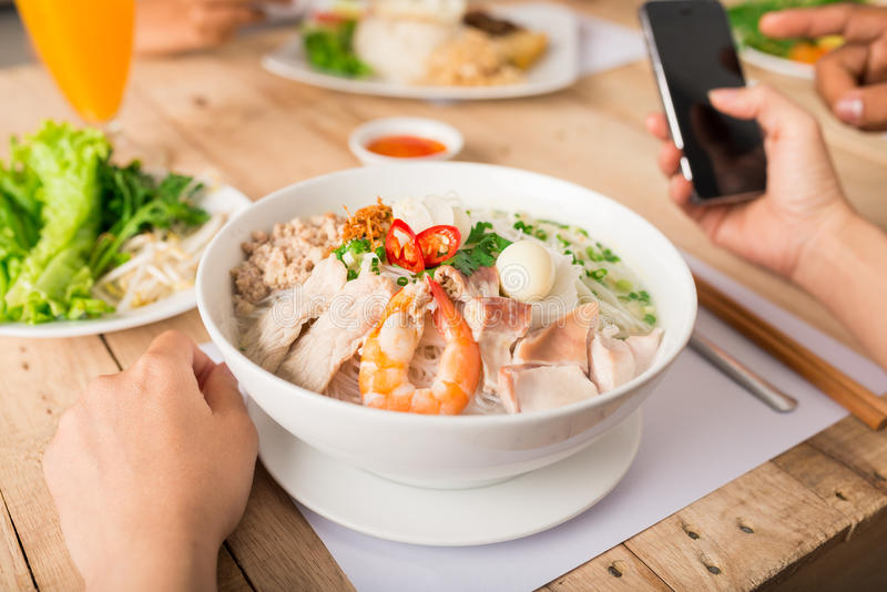 TRaditional Vietnamese soup. Bowl of Vietnamese beef soup Pho with shrimp royalty free stock photography