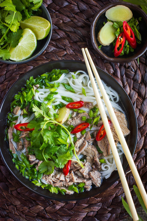 Traditional Vietnamese soup Pho with beef and rice noodle stock photo