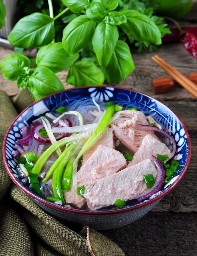 Traditional Vietnamese soup Pho with rice noodles, spring onions, onions, anise and cinnamon stock photo