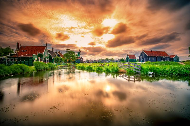Traditional village with dutch windmills and river at sunset, Holland, Netherlands. Zaanse Schans stock photography