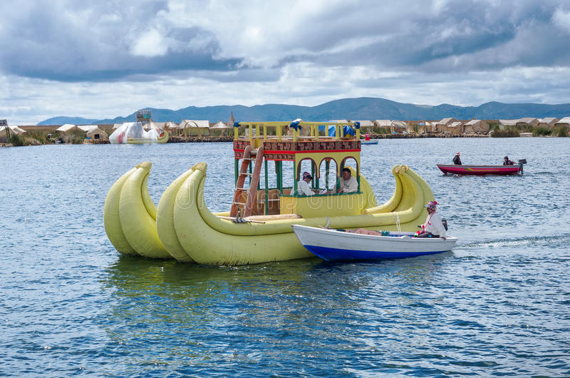 Traditional village on floating islands on lake Titicaca in Peru stock photography