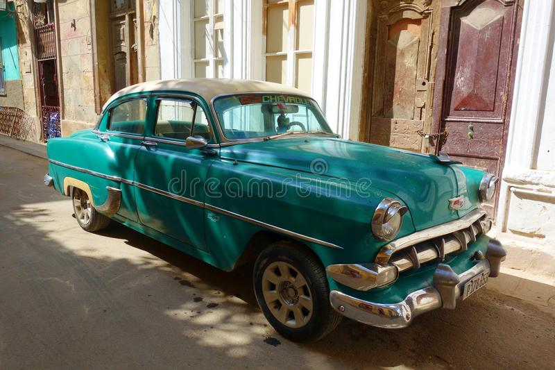 Colorful colonial buildings with old vintage car, Havana, Cuba royalty free stock image