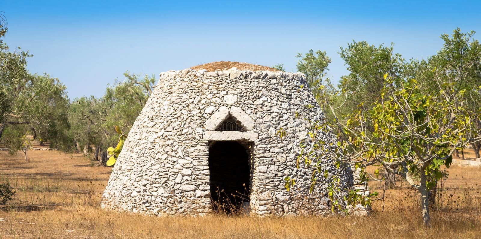 Puglia Region, Italy. Traditional warehouse made of stone. This traditional warehouse is named Furnieddhu in local dialect. All structure made of stone, used to royalty free stock image