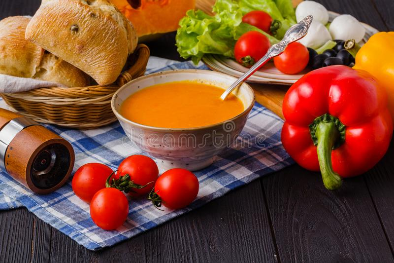 Traditional warming pumpkin soup, homemade with bread and antipasti stock images