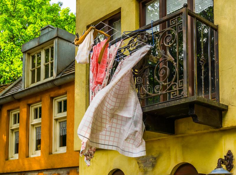 Traditional wash drying outside, clothes drying rack on a balcony, Vintage household equipment royalty free stock photos