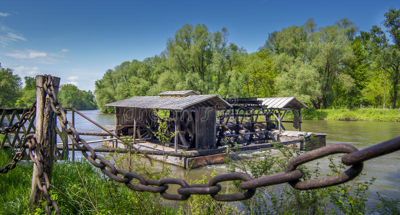 Traditional water mill on Mura river, Slovenia royalty free stock images