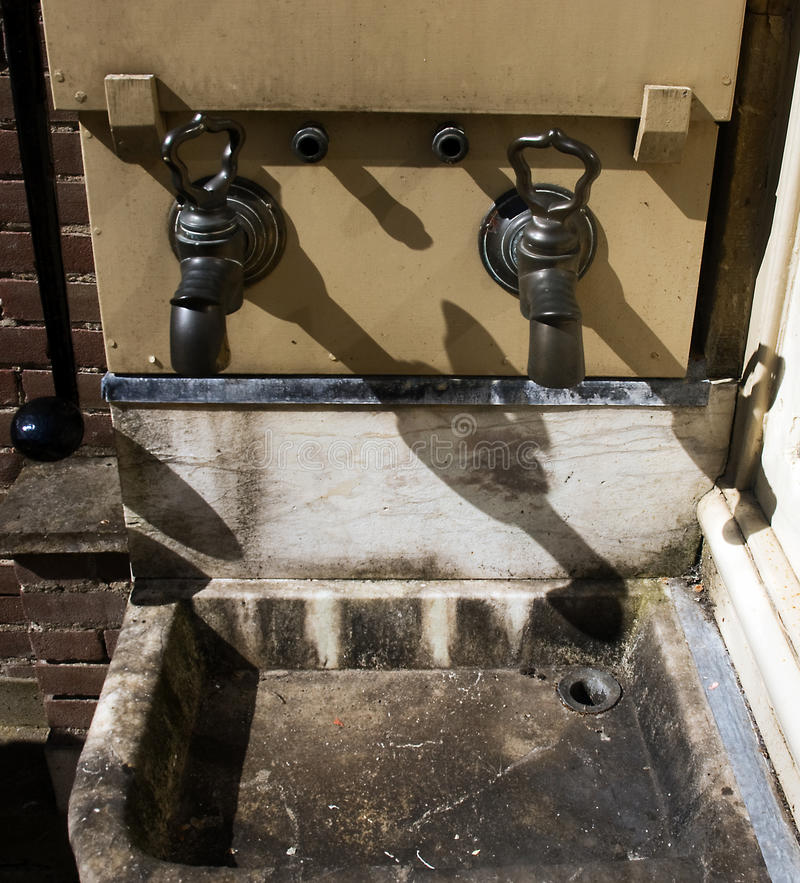 Traditional water taps and sink royalty free stock photo
