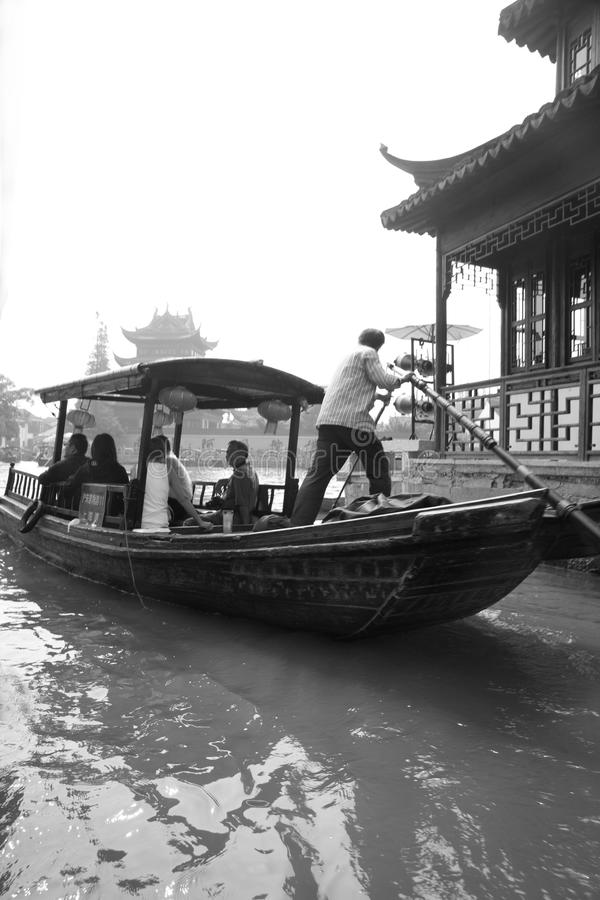 Traditional water taxi through the canals, Zhujiajiao, China. Traditional water taxi through the canals in the water town of Zhujiajiao, China in black & white stock images