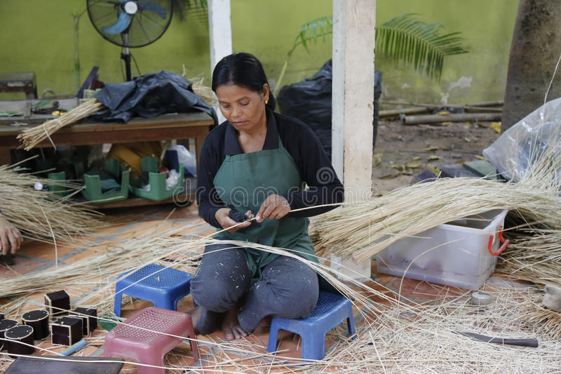 Traditional weaver in Siem Reap, Cambodia royalty free stock image