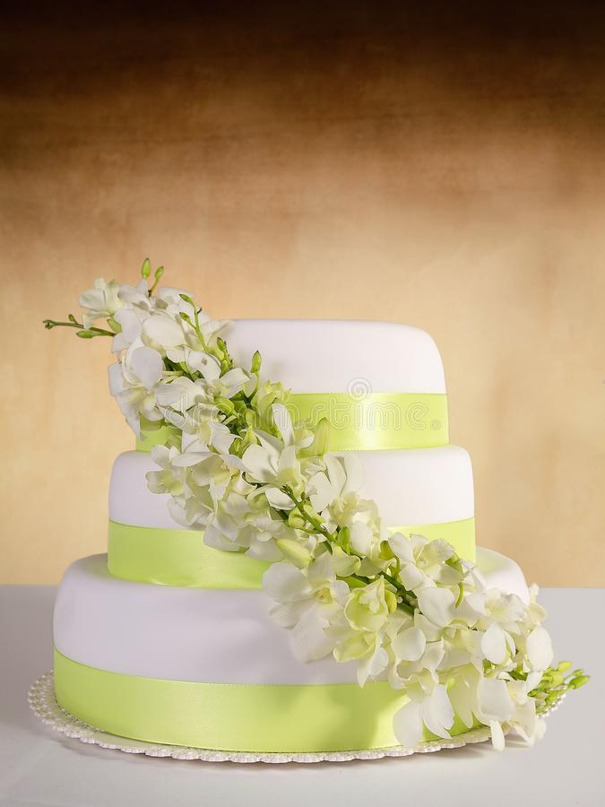 Traditional wedding cake with orchid flowers stock photo