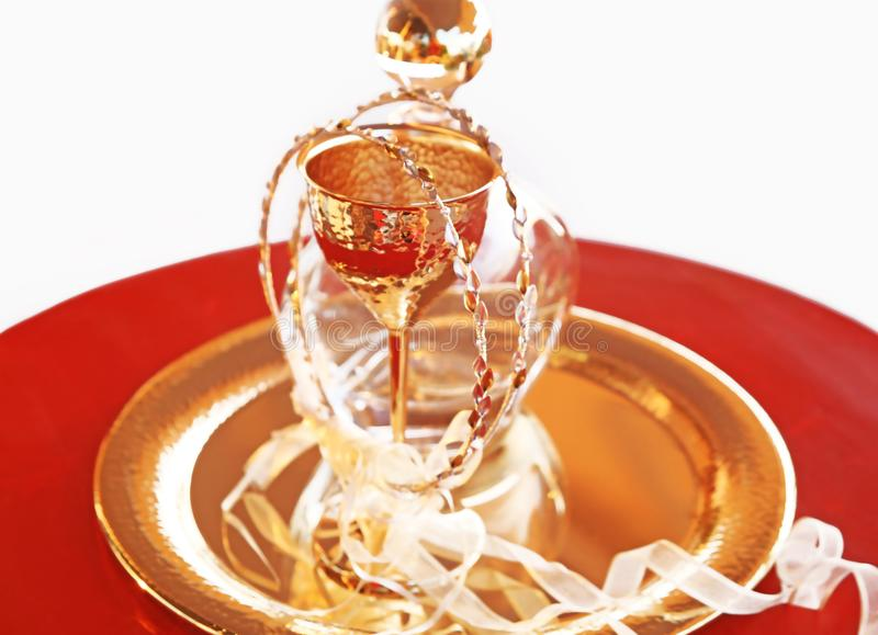 Traditional wedding crowns, decanter and chalice - greek wedding objects. Still life photography of traditional wedding crowns, decanter and chalice - greek stock photos