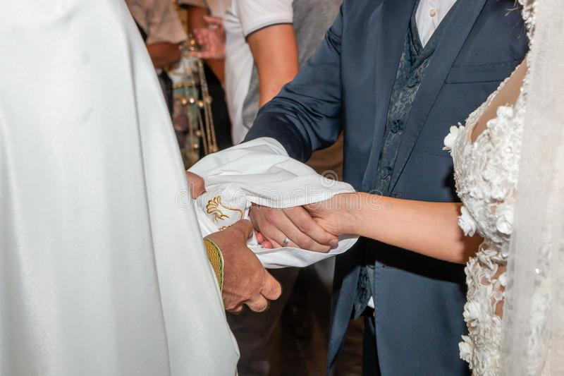 Traditional wedding handfasting in church royalty free stock photos