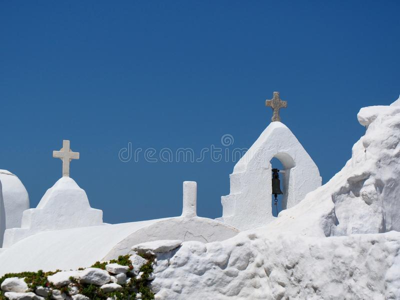 Traditional White Greek Catholic Church Bell Tower. Architecture, with crosses and blue sky background stock photography