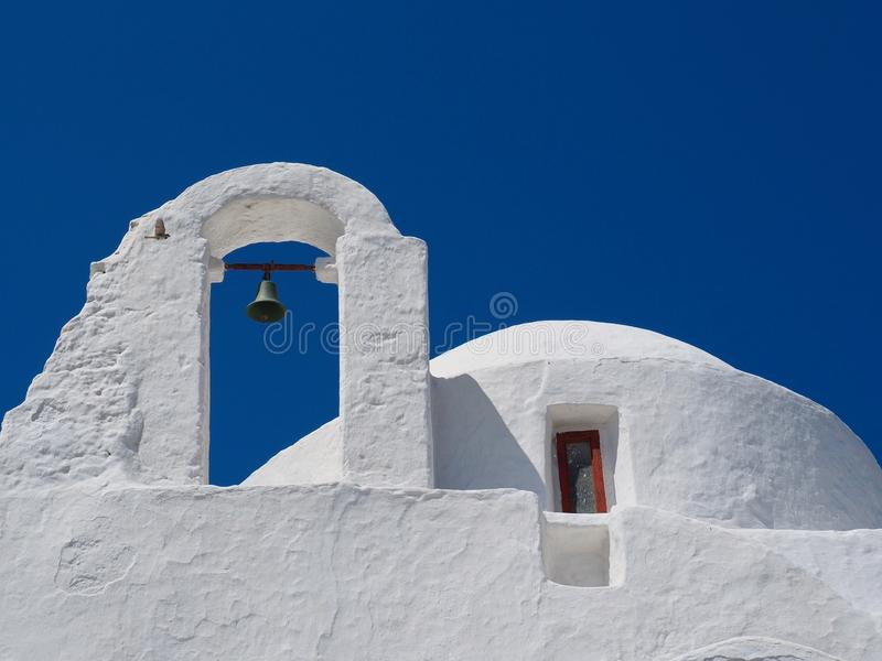 Traditional White Greek Catholic Church Bell Tower. Architecture, with window and blue sky background royalty free stock image