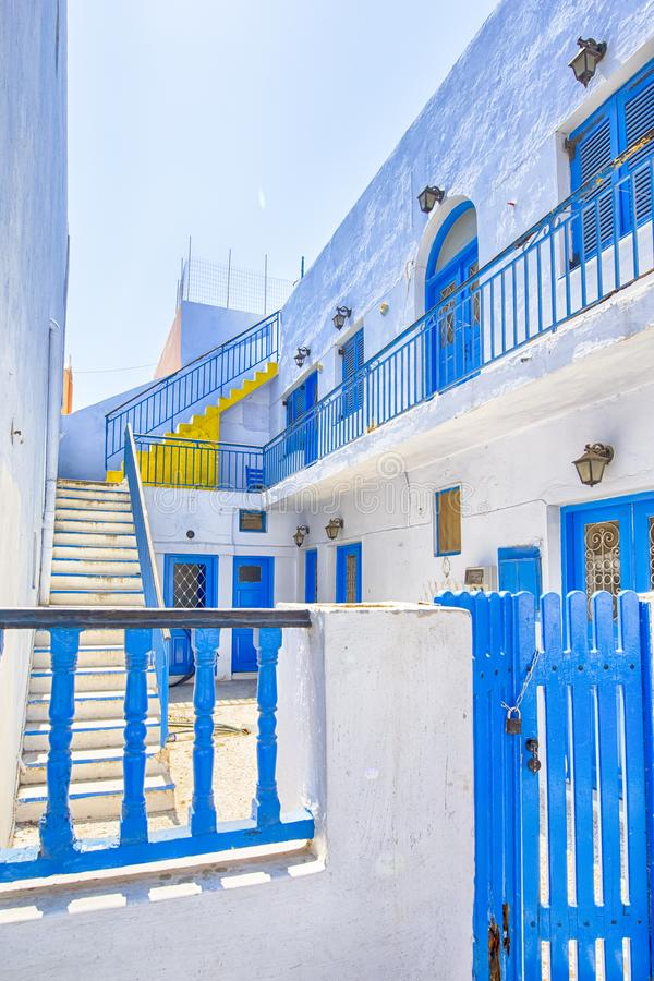 Traditional White Houses of Santorini Island in Greece with Blue Window Shutters. Vertical Image stock image