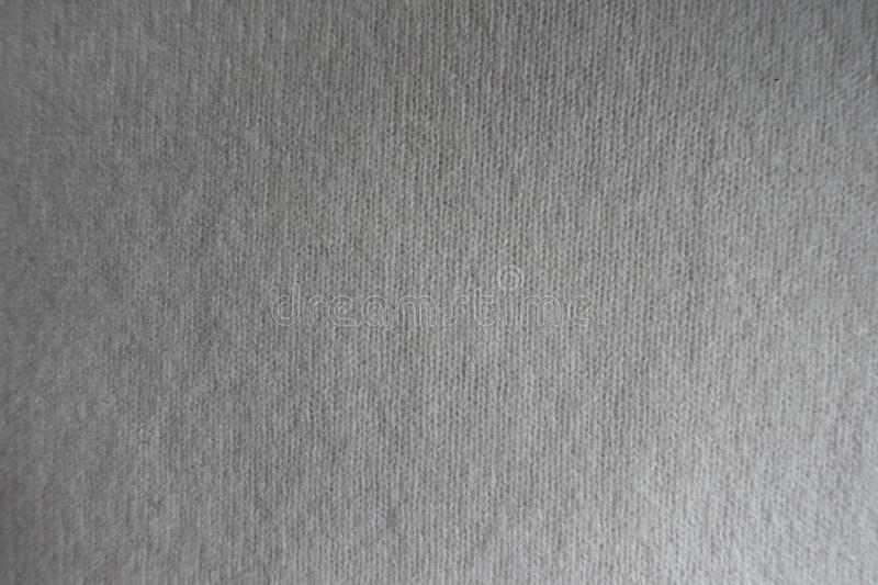 Traditional white woolen knit fabric from above. Traditional white woollen knit fabric from above royalty free stock photo
