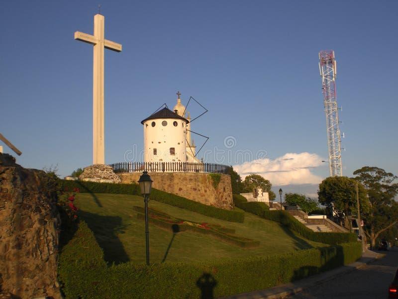 Traditional windmill and crucifix in Spain Europe. Traditional windmill in Spain Europe. emblematic architecture traditional wind stone Don Quijote Castilla la stock photos
