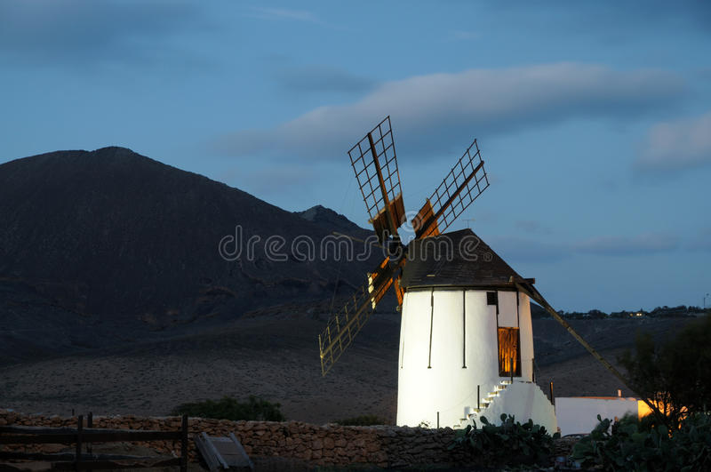 Traditional windmill at night stock images