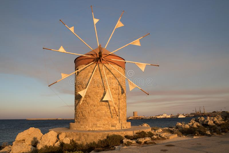 Traditional windmill in Rhodes,Greece. Traditional windmill in Mandraki port of Rhodes,Greece stock images