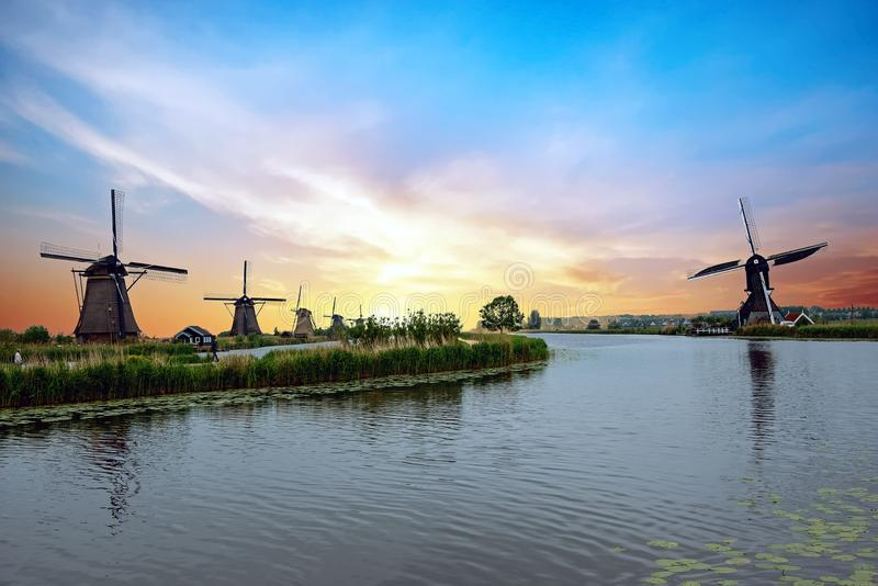 Traditional windmills at Kinderdijk in the Netherlands at sunset royalty free stock photography