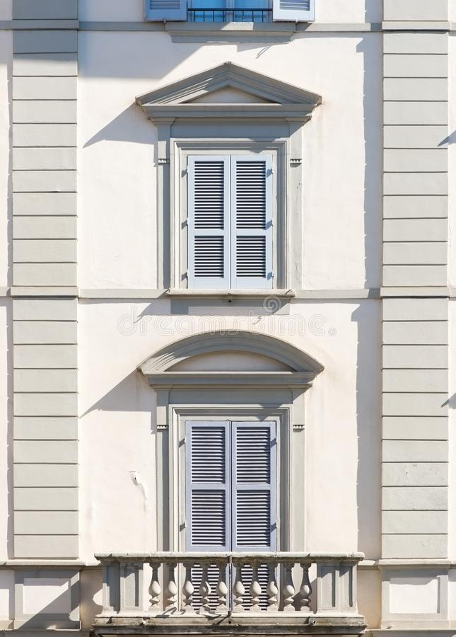 Traditional windows with shutters from Italy and balcony. Architectural detail outdoors stock photography