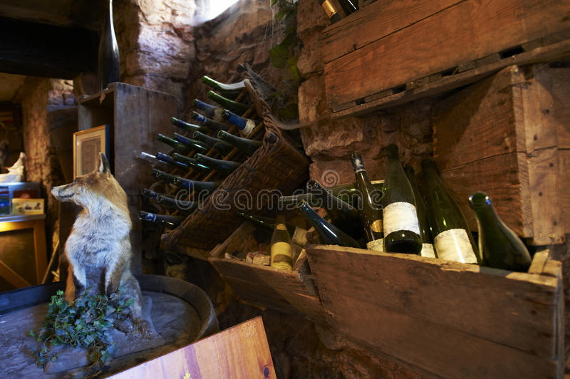 Traditional wine cellar. Inside an old and traditional wine cellar in France in a beautiful, ancient atmosphere with lots of nice decoration royalty free stock photos