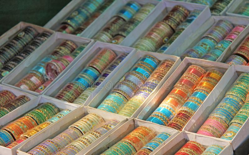 Traditional women`s bracelets are on hand India. Gift souvenir India. Market Bazaar sale of jewelry. Jewelery India.  stock images