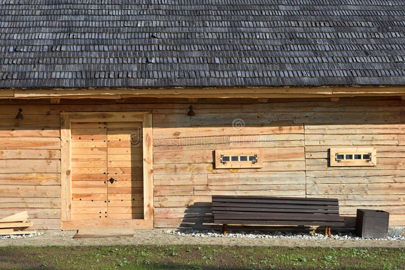 Traditional wood barn with wood door. And small windows royalty free stock photos