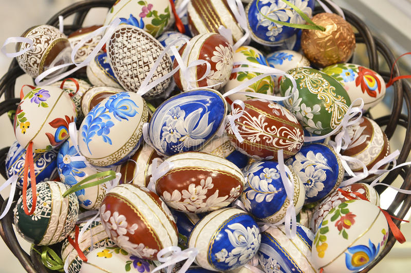 Traditional wood basket with painted Easter egg from Bucovina, Romania. royalty free stock image