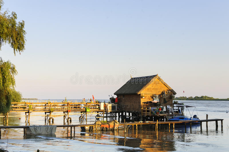 Traditional wood house on water stock photo