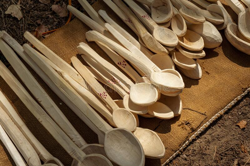 Traditional wood spoons handcrafted by the locals in the rural villages of Romania. Handcrafted tools stock photo