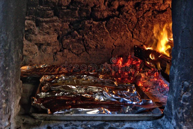Traditional wood stove, cooking fish on the coals, Oaxaca. Traditional wood stove, cooking fish on the coals stock photos