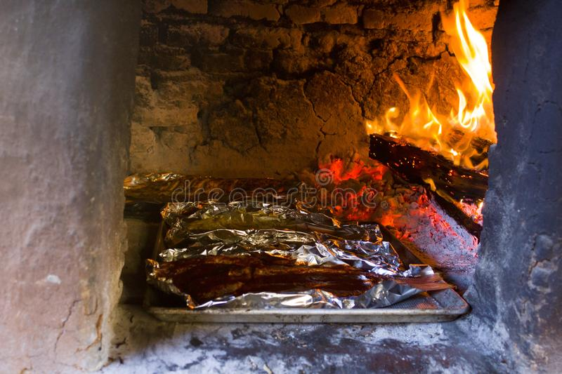 Traditional wood stove, cooking fish on the coals, Oaxaca. Traditional wood stove, cooking fish on the coals stock image