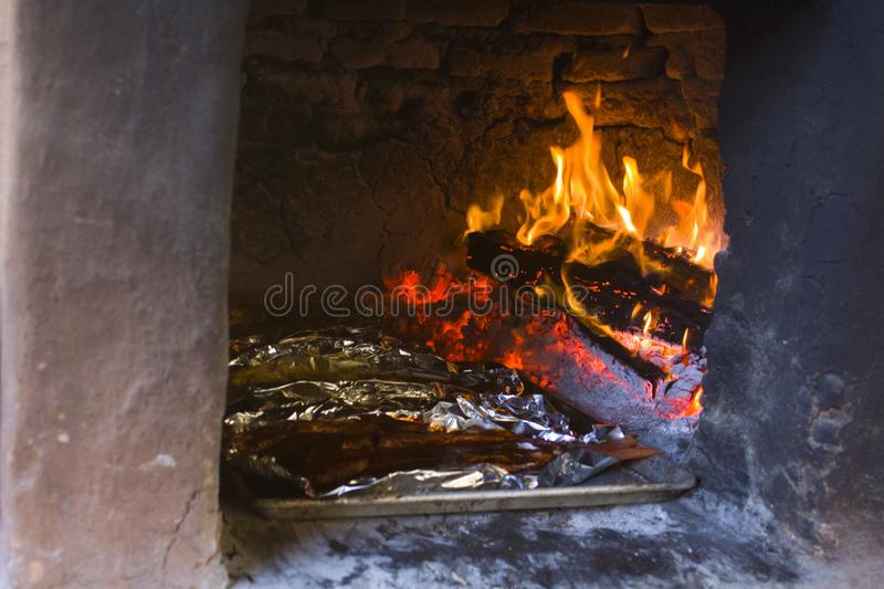 traditional wood stove, cooking fish on the coals, Oaxaca royalty free stock photos