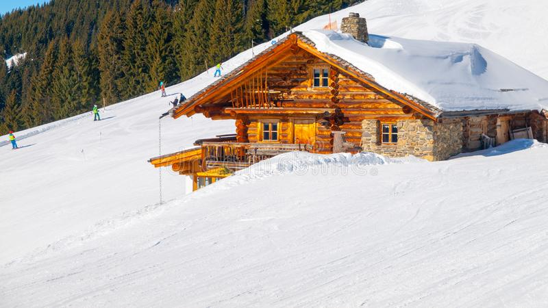 Traditional wooden alpine chalet on sunny winter day. Alps, Europe stock photo