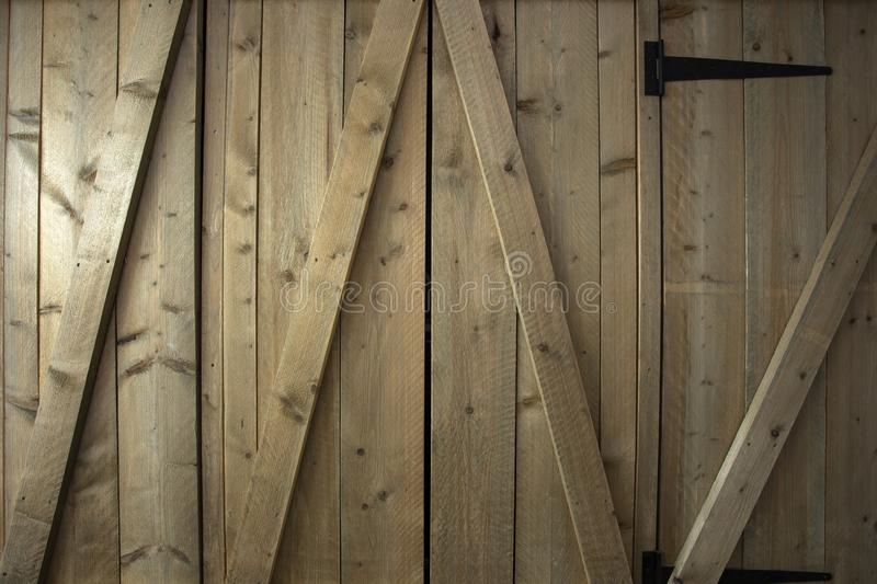 Traditional wooden barn doors detail of farm house doors, close-up clean and modern. Background textue stock image