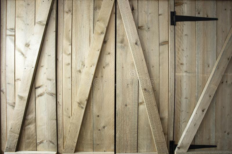 Traditional wooden barn doors detail of farm house doors, close-up clean and modern. Background textue stock photos