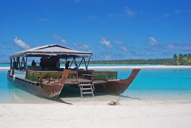 Traditional wooden boat docked at One Foot Island, Aitutaki, Cook Islands royalty free stock photos