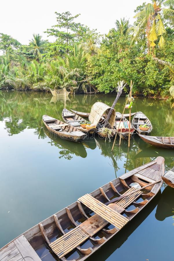 Traditional wooden boat in a small river in the Mekong Delta region of southern Vietnam royalty free stock images