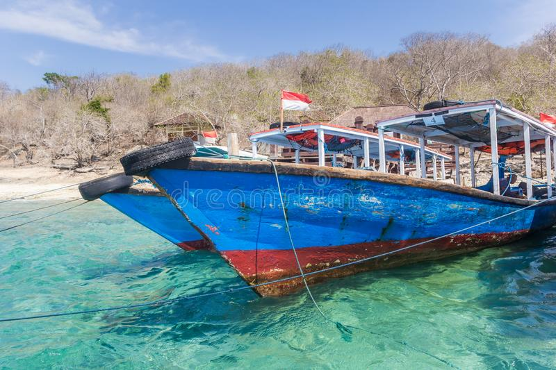 Traditional wooden boats at the beach of Menjangan Island. Indonesia royalty free stock images