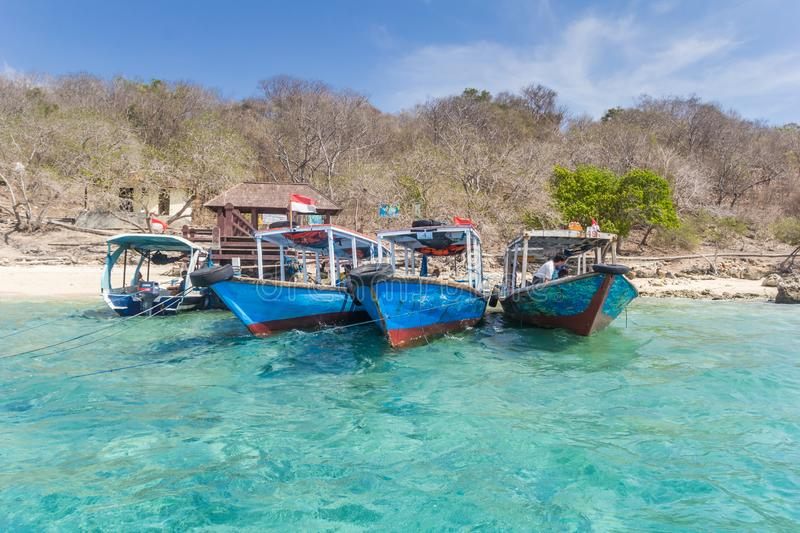 Traditional wooden boats at the beach of Menjangan Island. Indonesia stock photography
