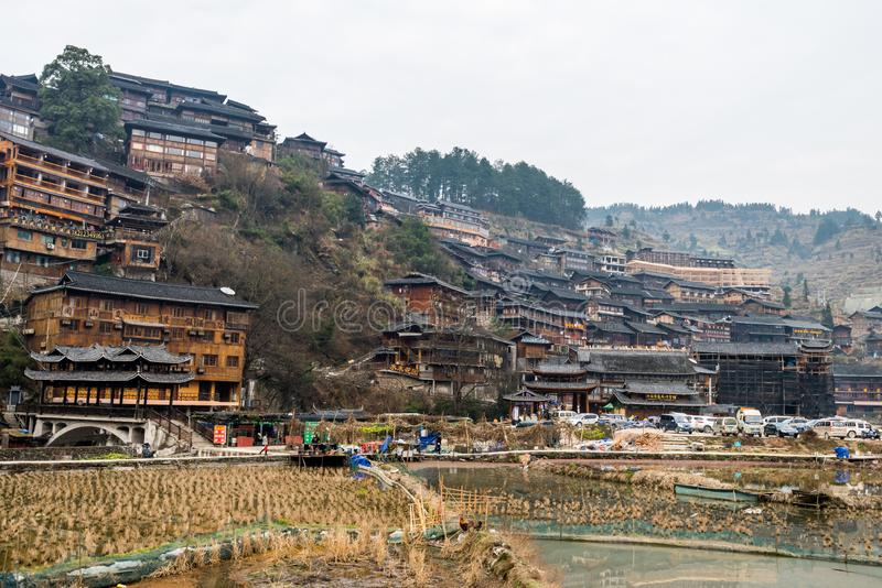 Traditional wooden building cluster at the bank of river of Xijiang Qianhu Miao Village The One Thousand Household Miao Village stock images