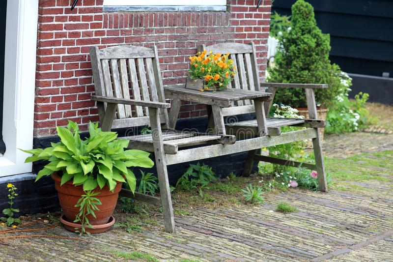 Traditional wooden chair at zaanse schans in The Netherlands close to Amsterdam. Unique beautiful European city royalty free stock image