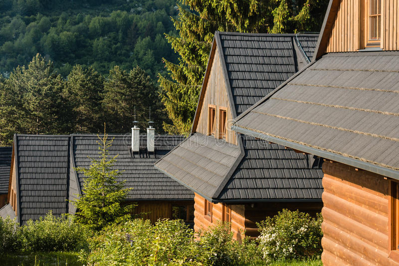 Traditional wooden chalets. With slated roofs stock image